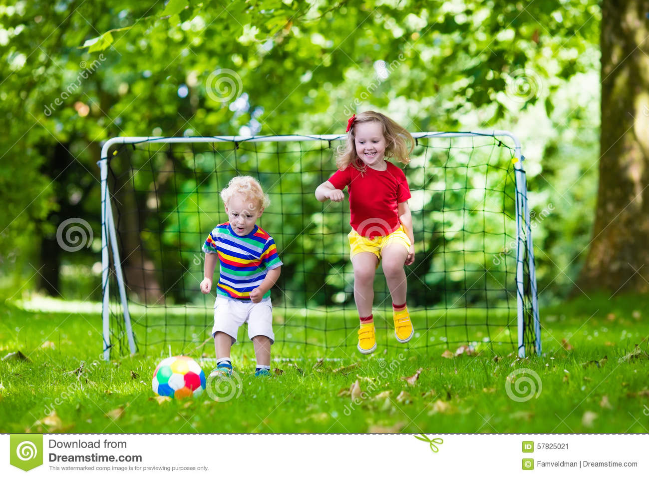 Kids playing football in school yard stock image image for Childrens play yard