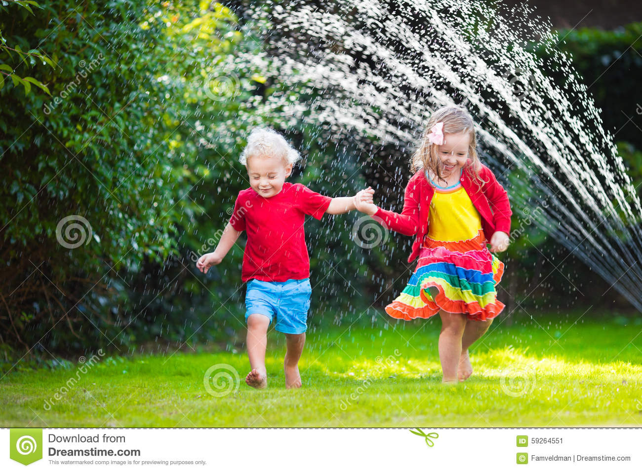 kids playing with garden sprinkler stock photo image 59264551