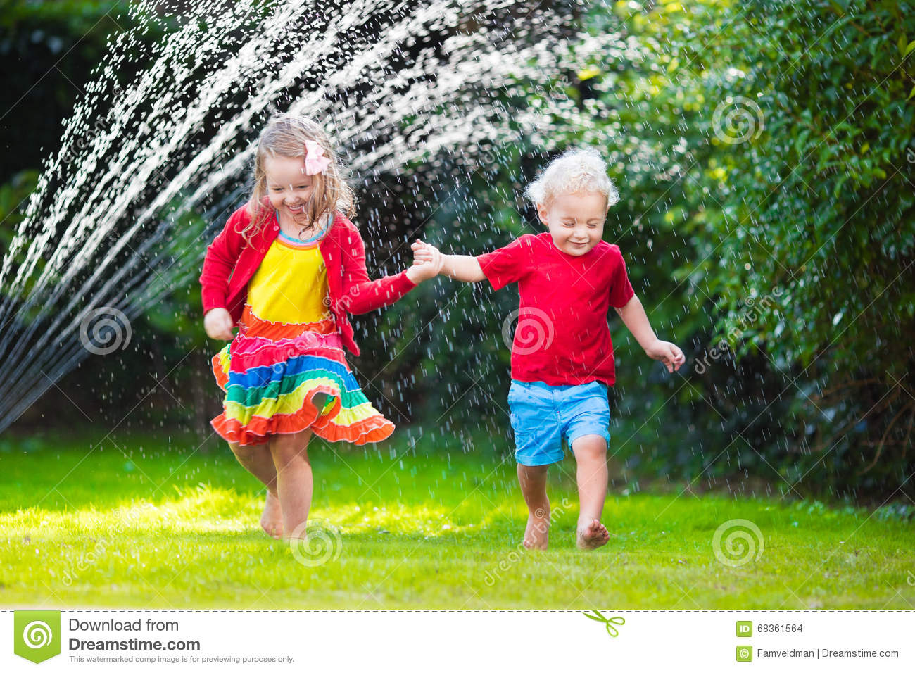 Kids playing with garden sprinkler stock photo image for Childrens play yard
