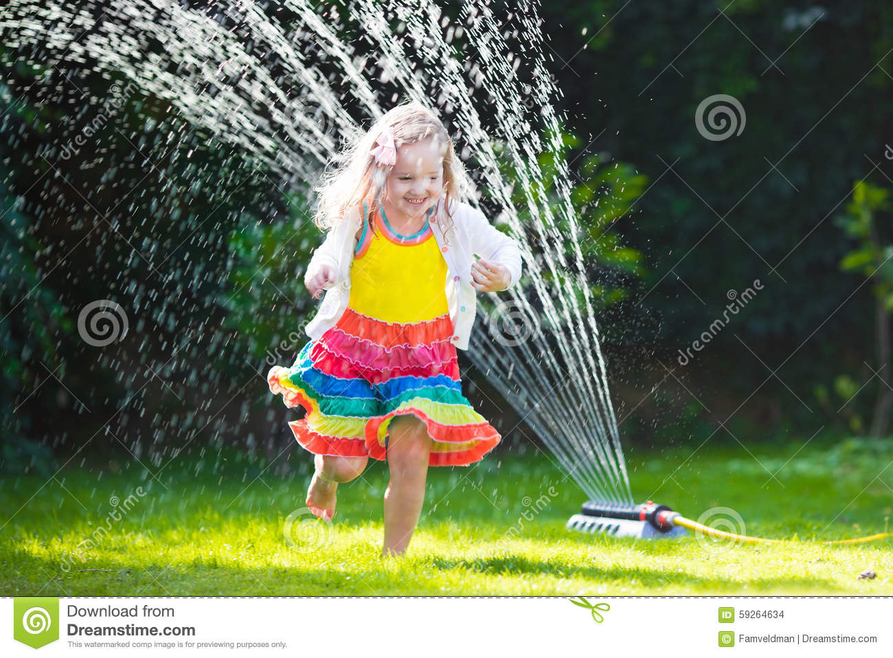 kids playing with garden sprinkler stock photo image