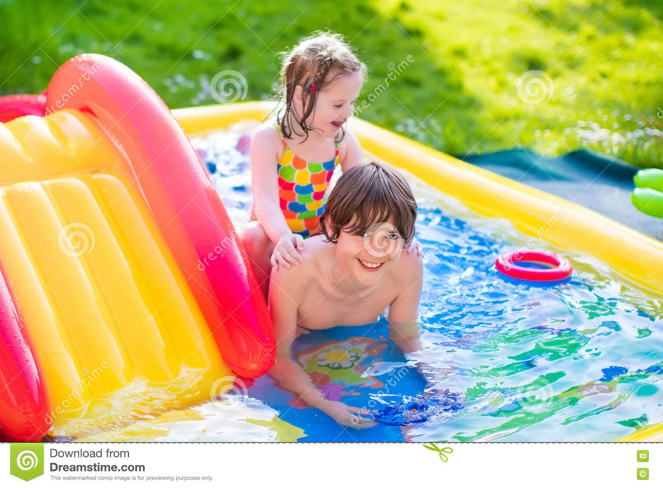 girl and boy playing in the pool