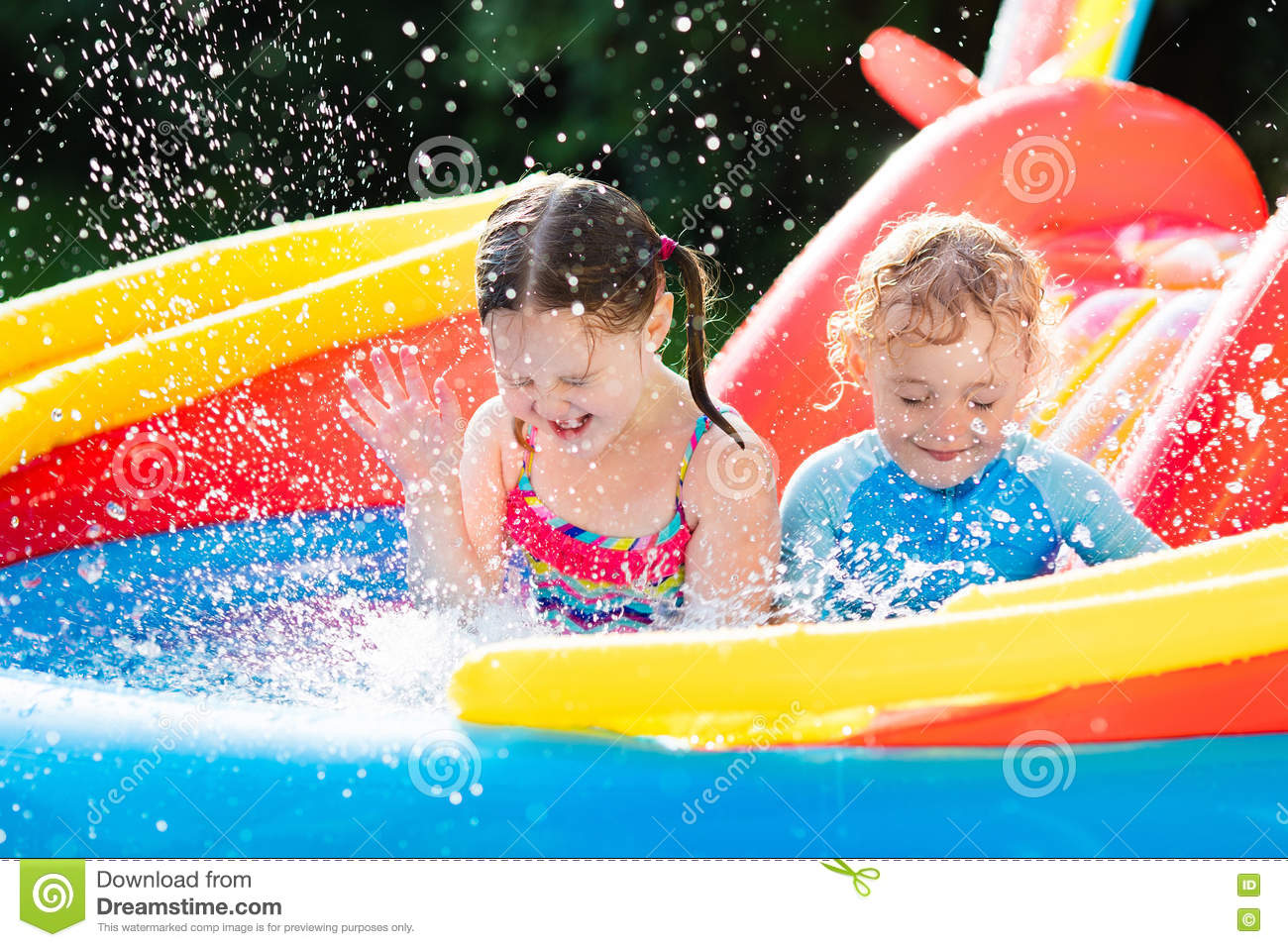 Kids playing in inflatable swimming pool stock photo for Kids swimming pool