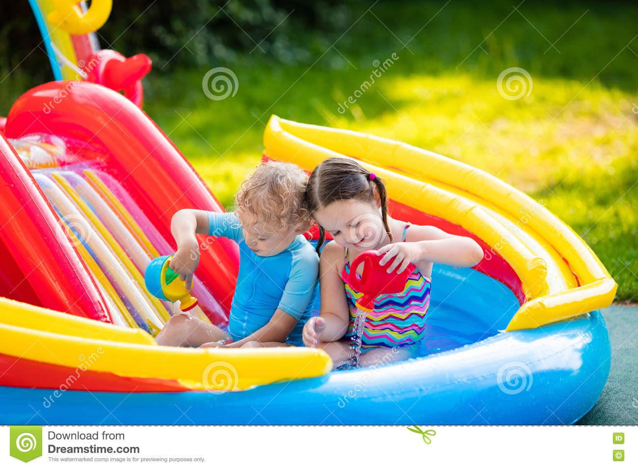 Kids Playing In Inflatable Swimming Pool Stock Photo Image 74613405