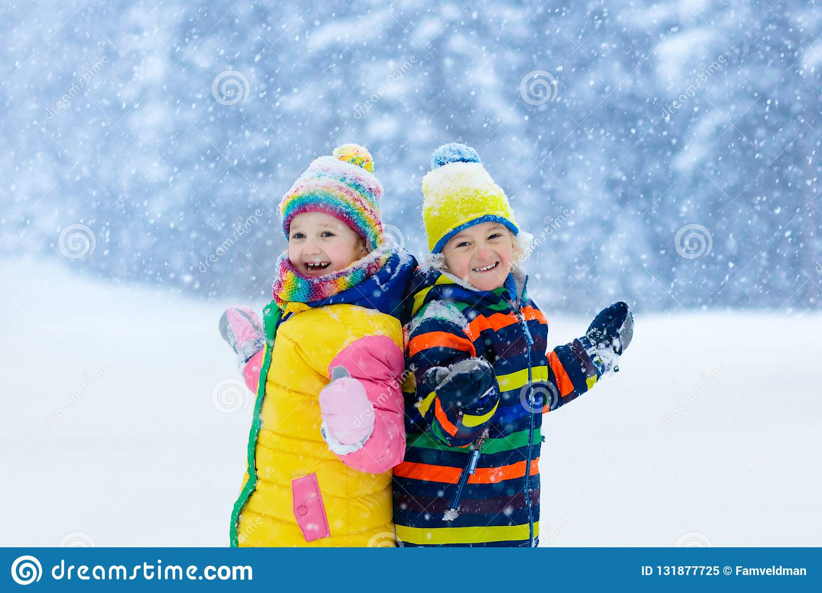 59bf5af09c79 Kids Playing In Snow. Children Play In Winter Stock Image - Image of ...