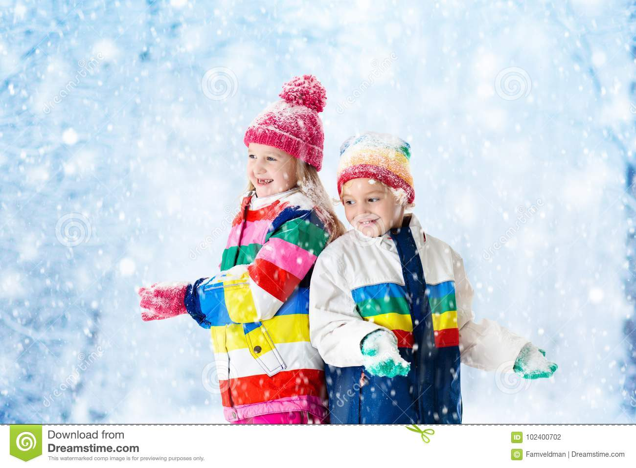d1088d1630cd Kids Playing In Snow. Children Play Outdoors In Winter Snowfall ...