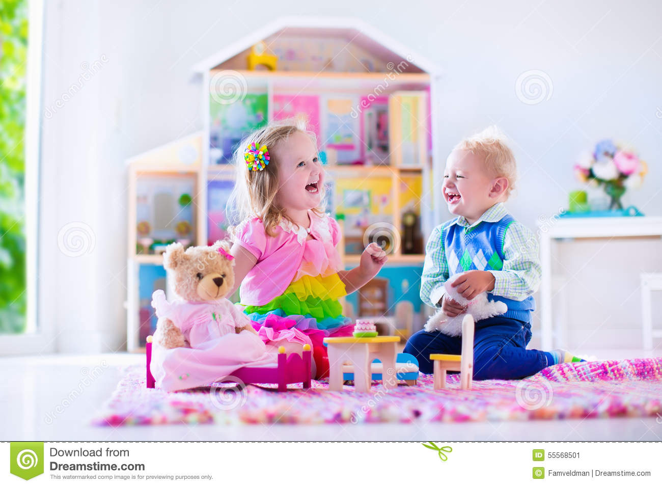 Kinder Garden: Kids Playing With Stuffed Animals And Doll House Stock