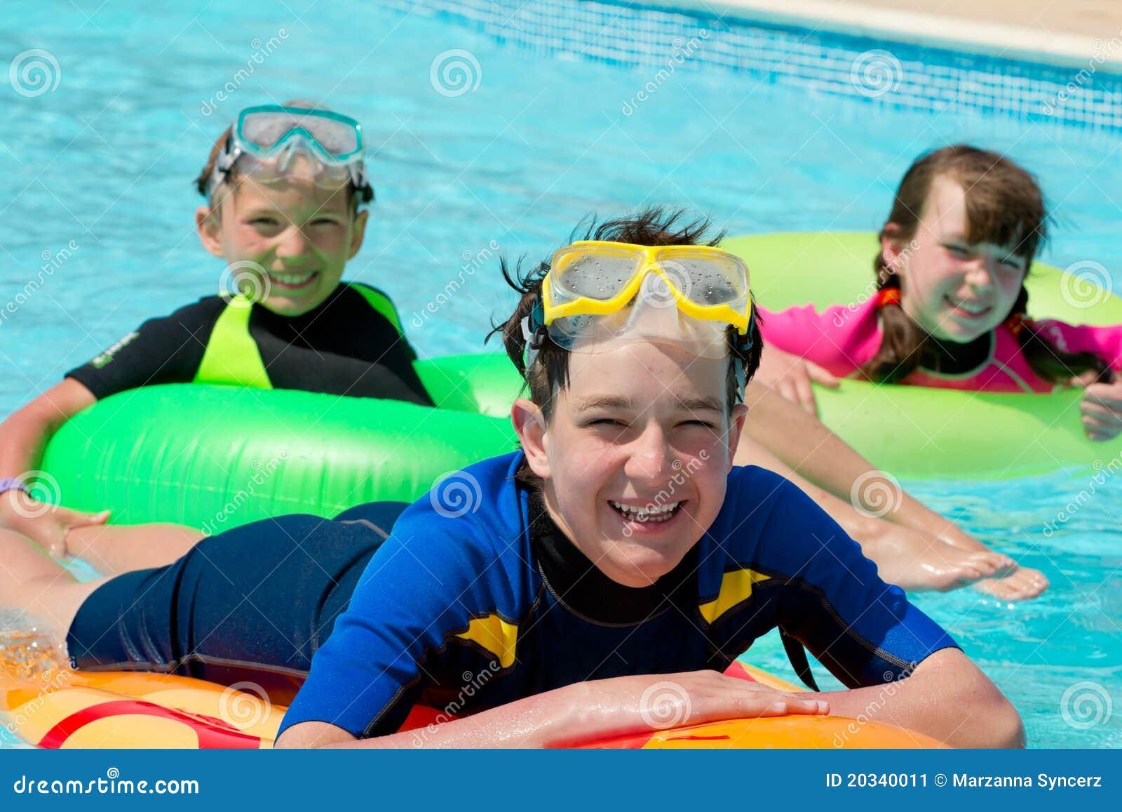 Kids Playing In Swimming Pool Stock Image - Image: 20340011