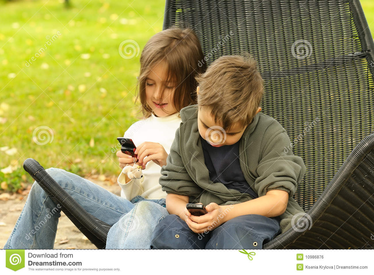 Kids Playing To A Cell Phone Stock Photo Image Of