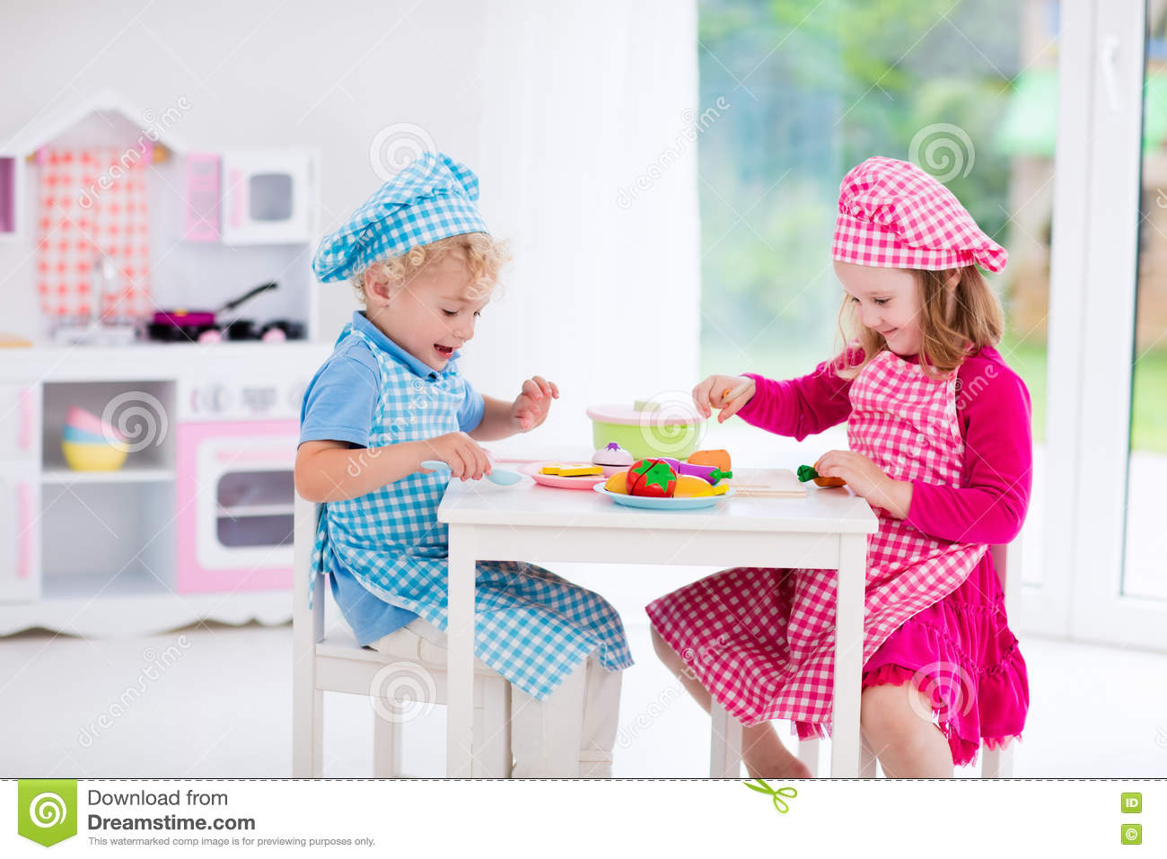 Little Girl Toys : Kids playing with toy kitchen royalty free stock photo