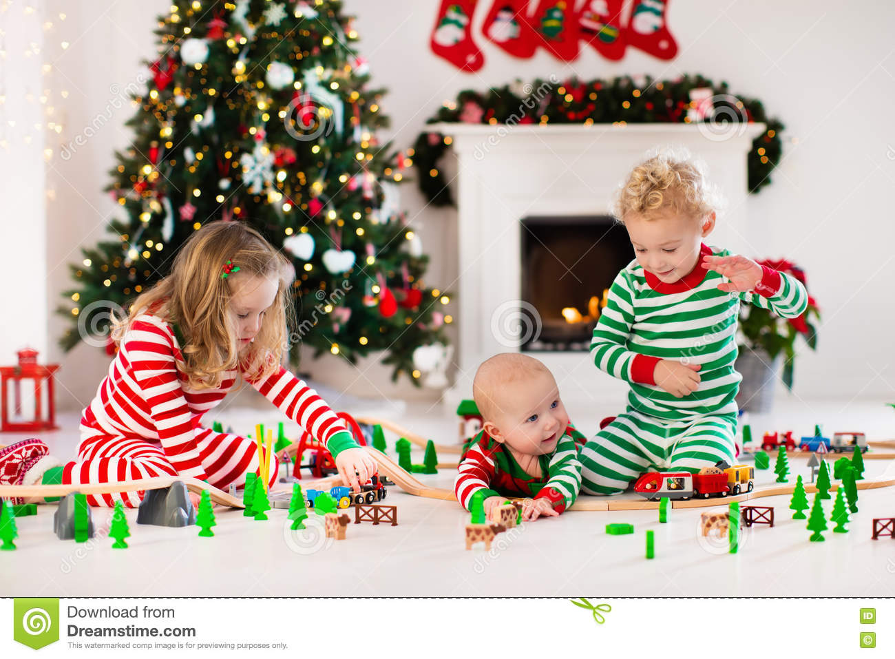 Kids Playing With Toy Railroad On Christmas Morning Stock Photo ...