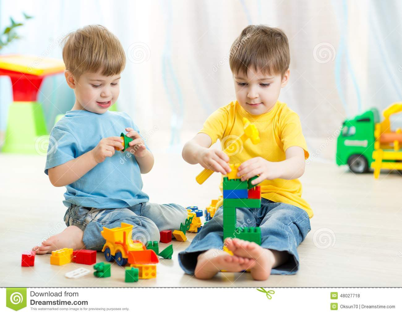 Kids Playing Toys In Playroom At Nursery Stock Photo