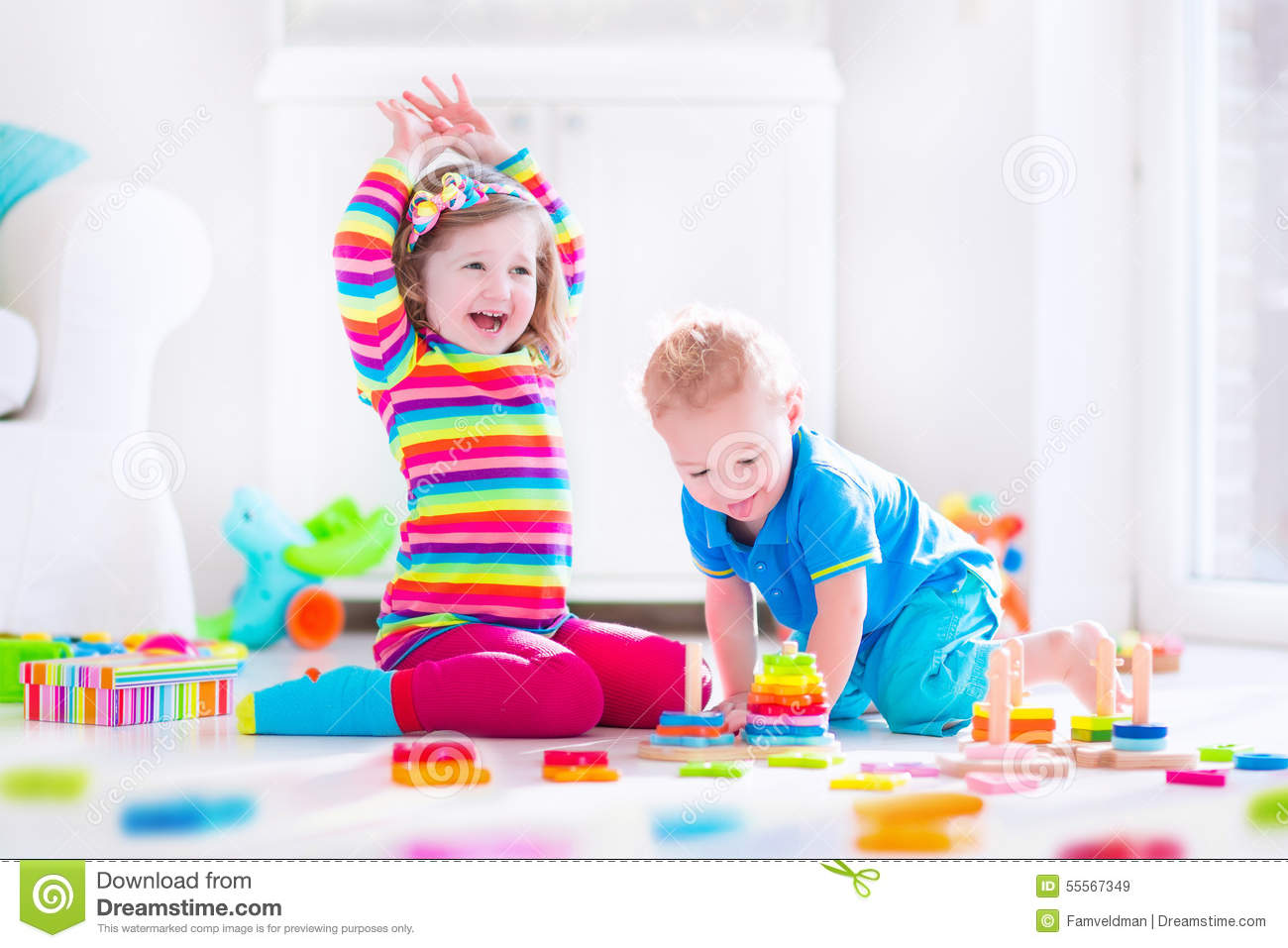 Toys At Play : Kids playing with wooden blocks stock image