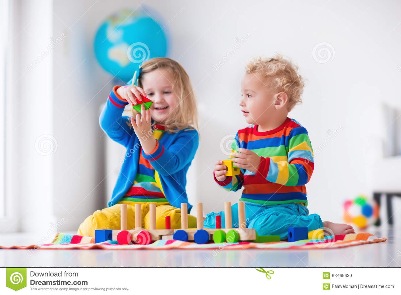 Kinder Garden: Kids Playing With Wooden Toy Train Stock Photo
