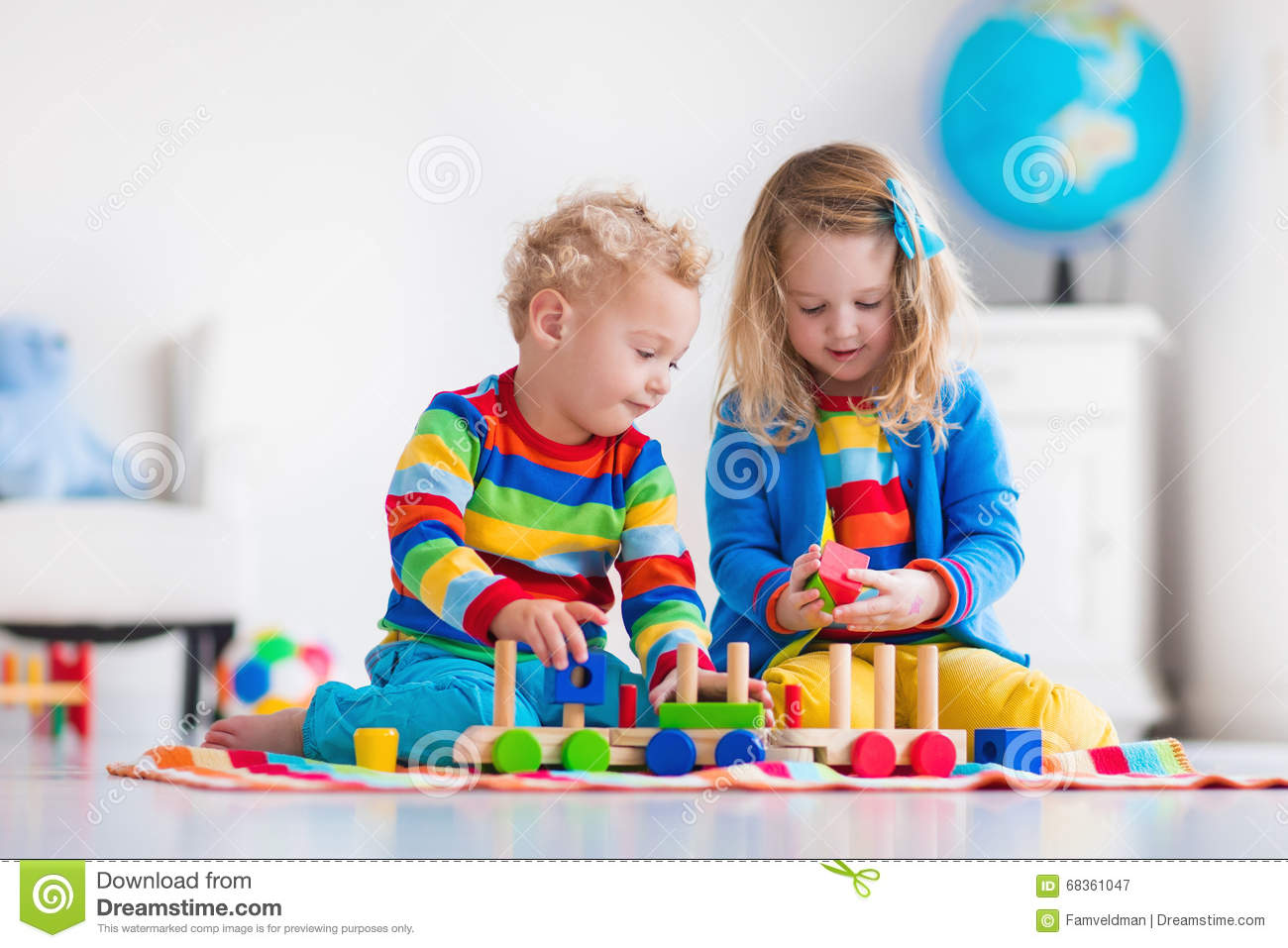 Toys At Play : Kids playing with wooden toy train stock image