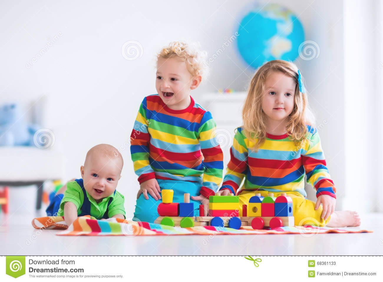 Toddler Toys Photography : Kids playing with wooden toy train stock image of