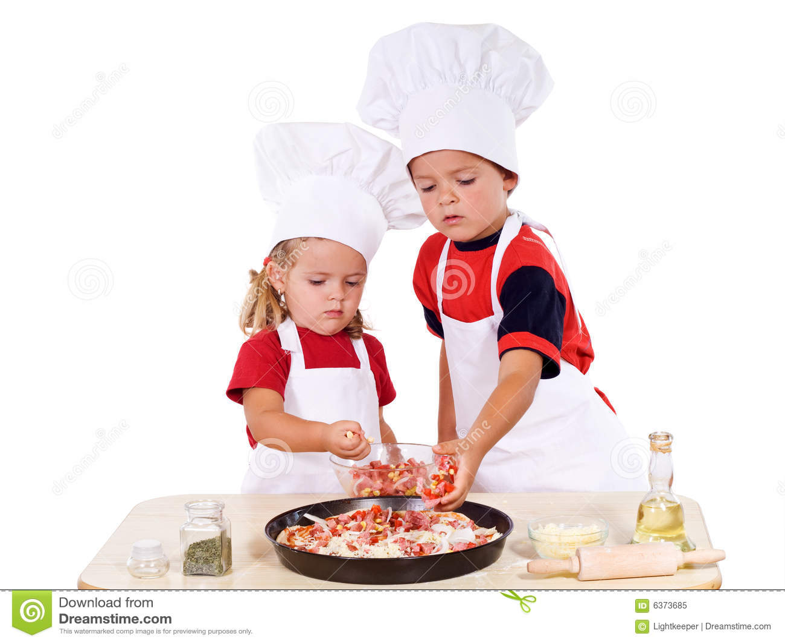 Kids preparing pizza