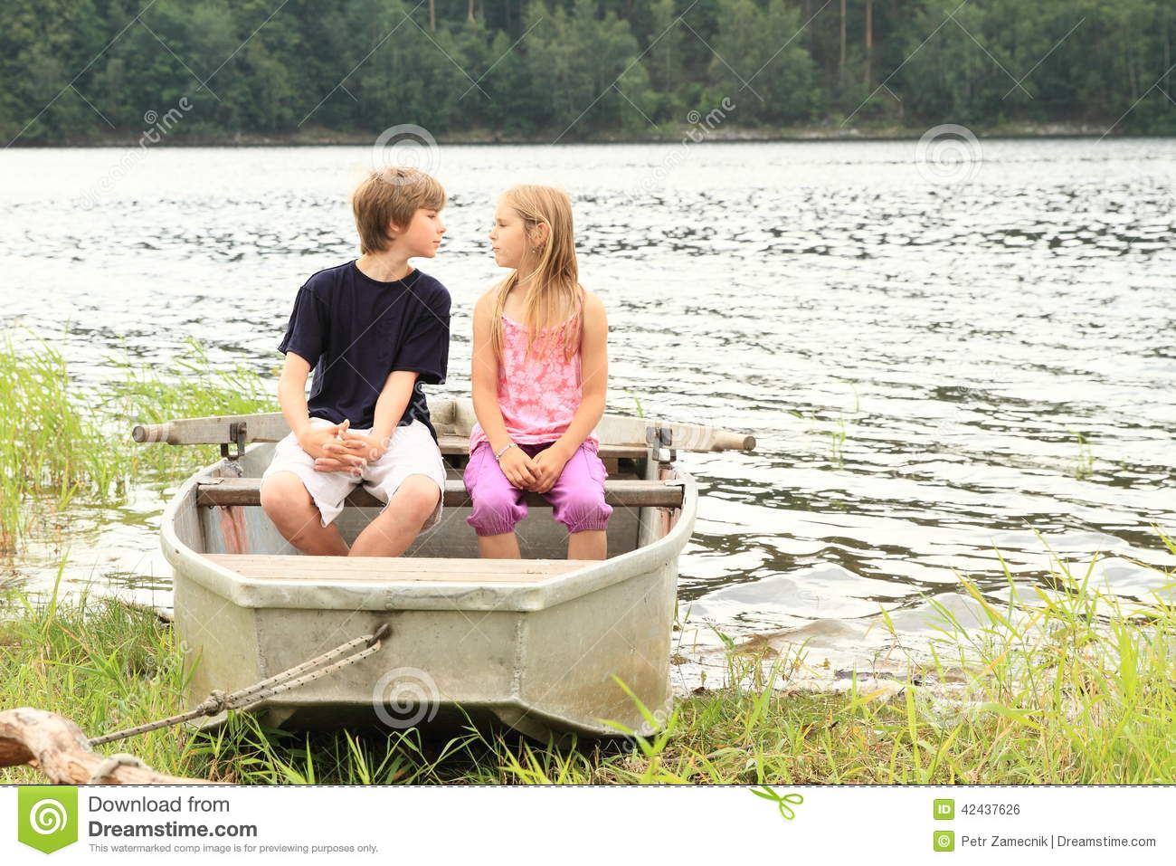 Kids in punt - first kiss stock photo. Image of inloved - 42437626