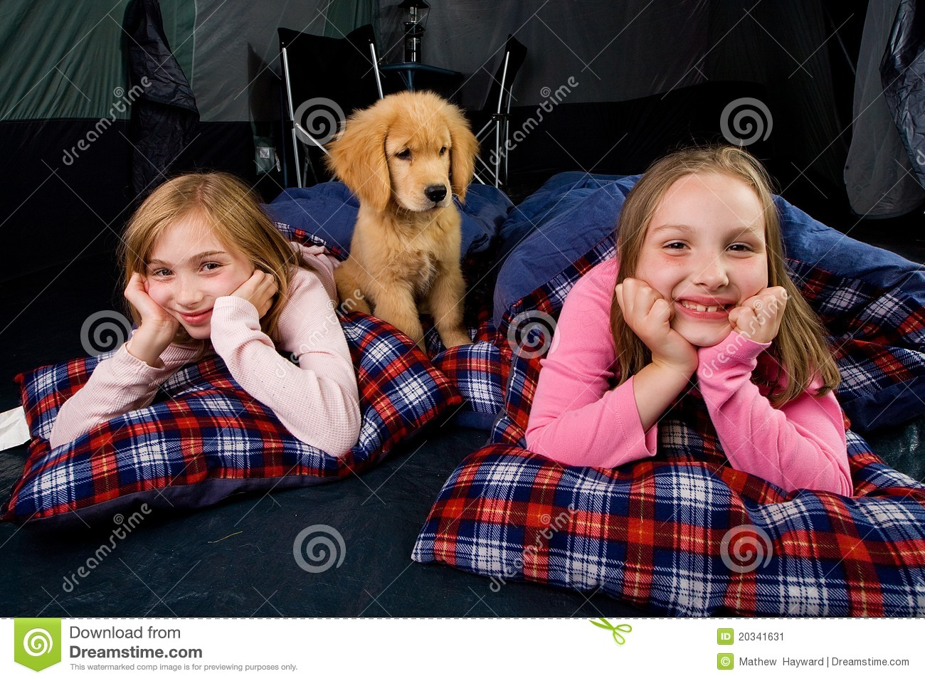 Kids and a puppy in a tent