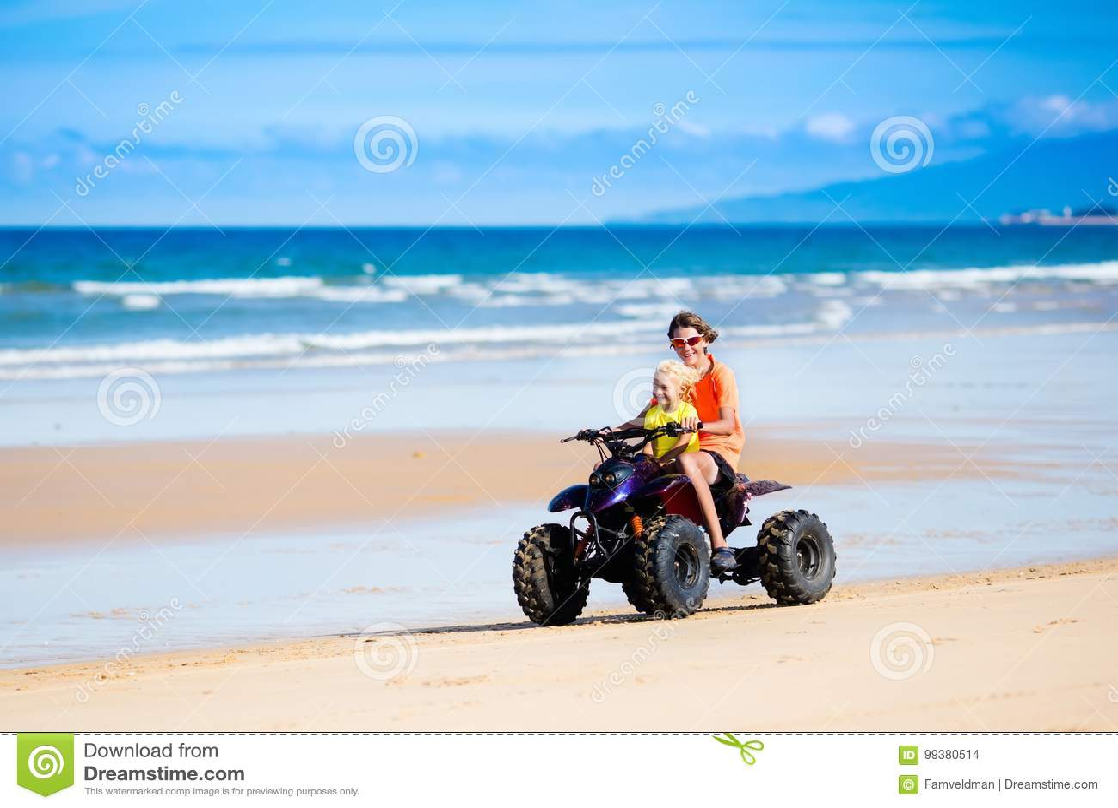Kids On Quad Bike  Off Road All Terrain Vehicle  Stock Photo