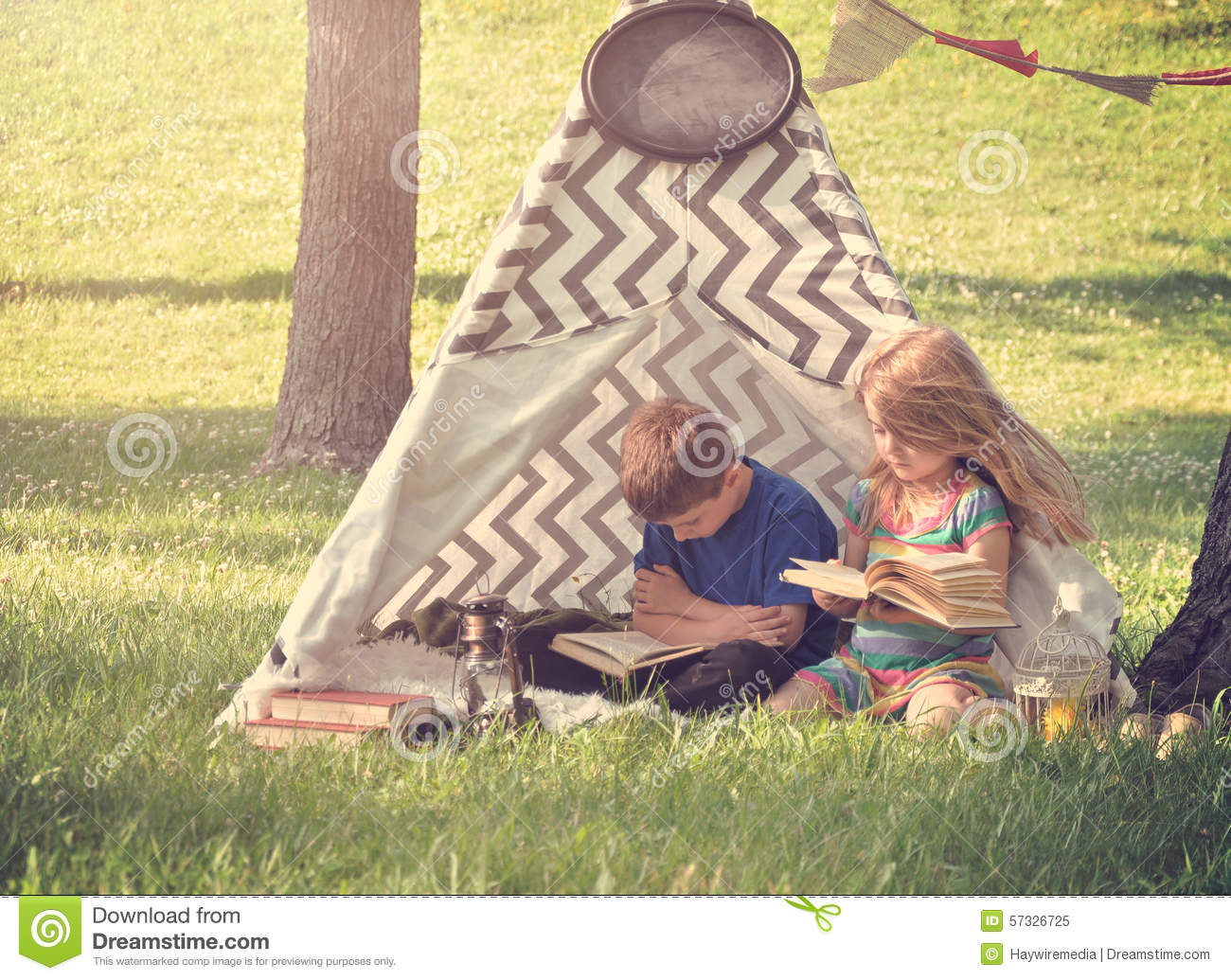 Kids Reading Books Outside in Tent Teepee