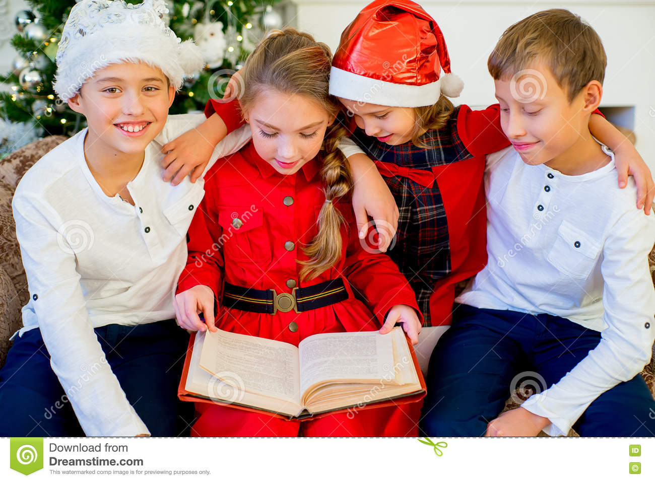 Kids Reading A Story Book On Christmas Time Stock Photo - Image of ...