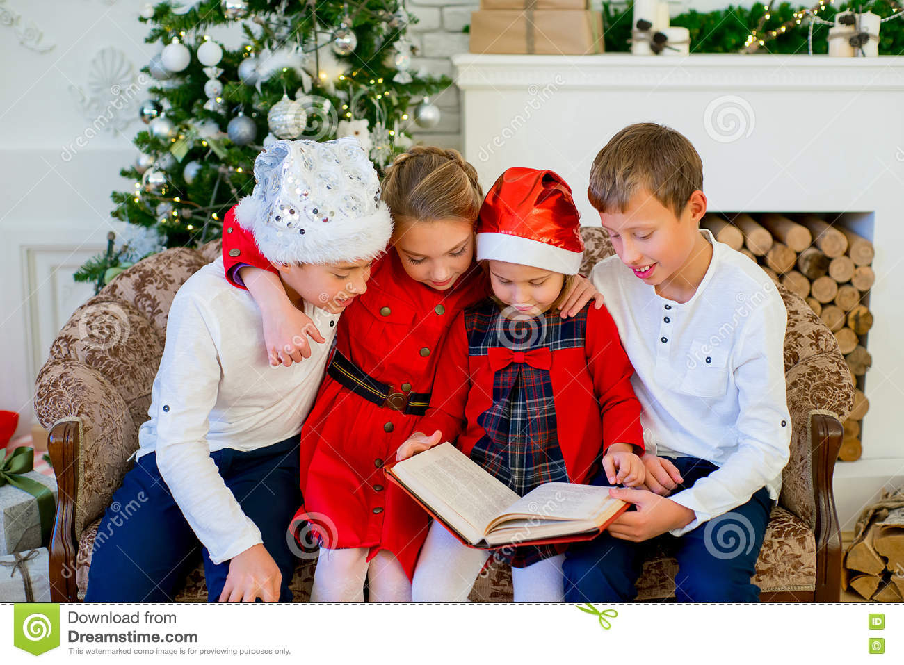 Kids Reading A Story Book On Christmas Time Stock Image - Image of ...