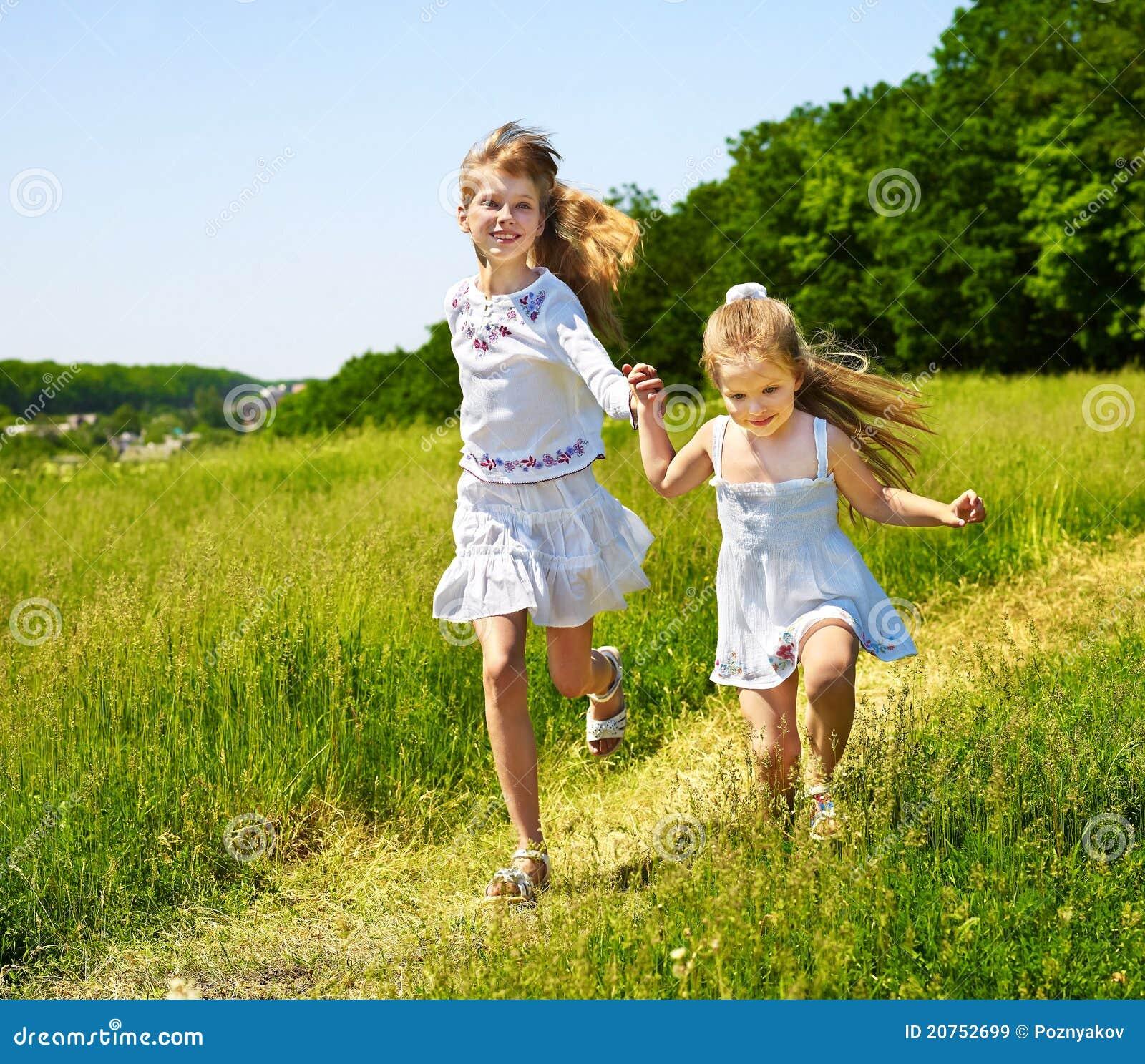 Little Kid Running Through Grass