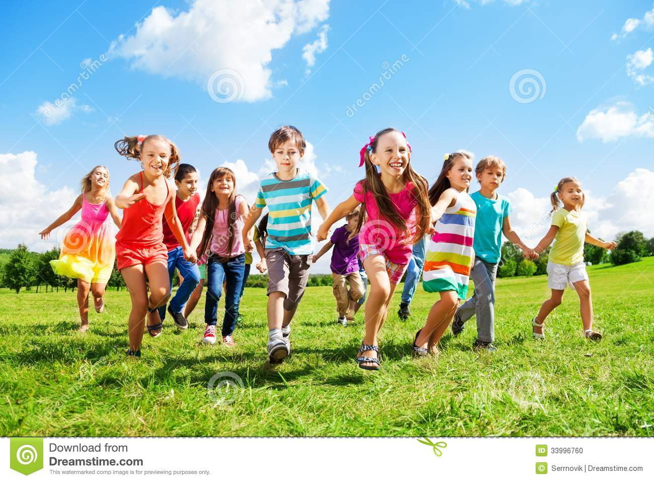 Many different kids, boys and girls running in the park on sunny ...
