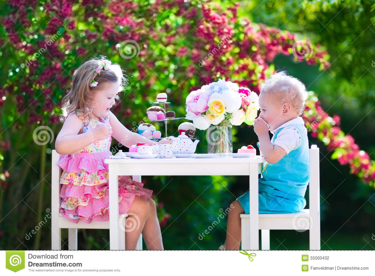 Kids Siblings Having Fun At Garden Tea Party Stock Photo