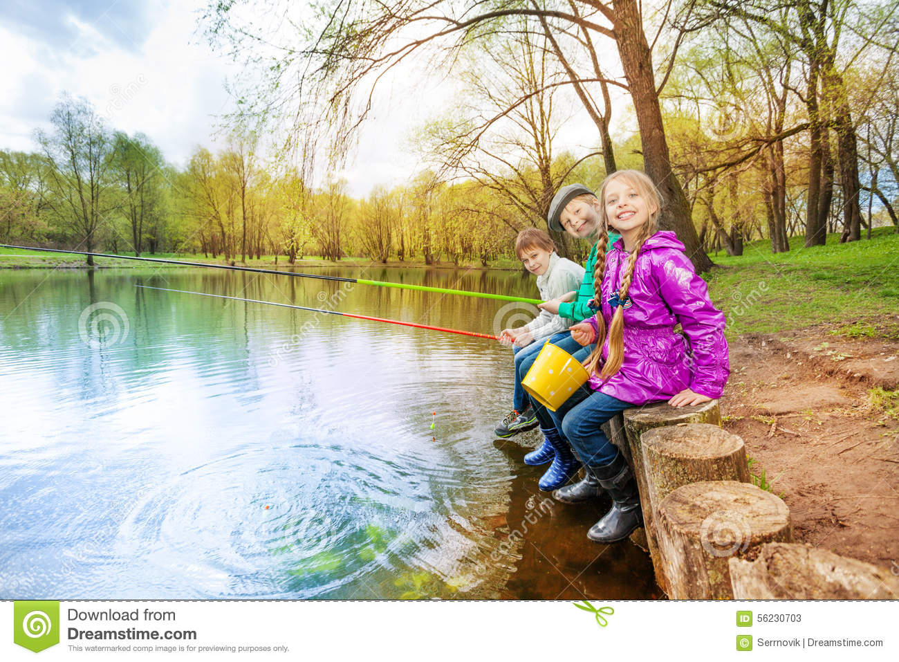 Kids sitting near pond holding fishing tackles stock photo for Children s fish book