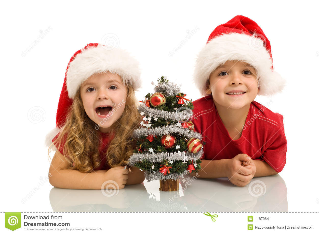 Kids With Small Decorated Tree At Christmas Time Stock Image - Image ...