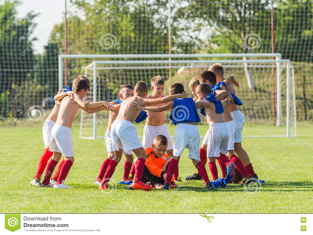 f6ed9642c8e Kids soccer team in huddle stock photo. Image of arms - 76985962