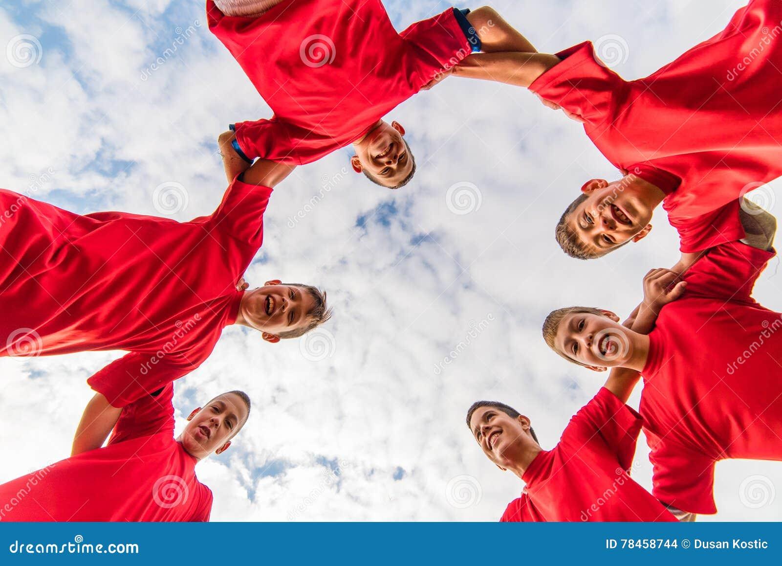 fe975d40651 Kids soccer team in huddle stock photo. Image of boys - 78458744