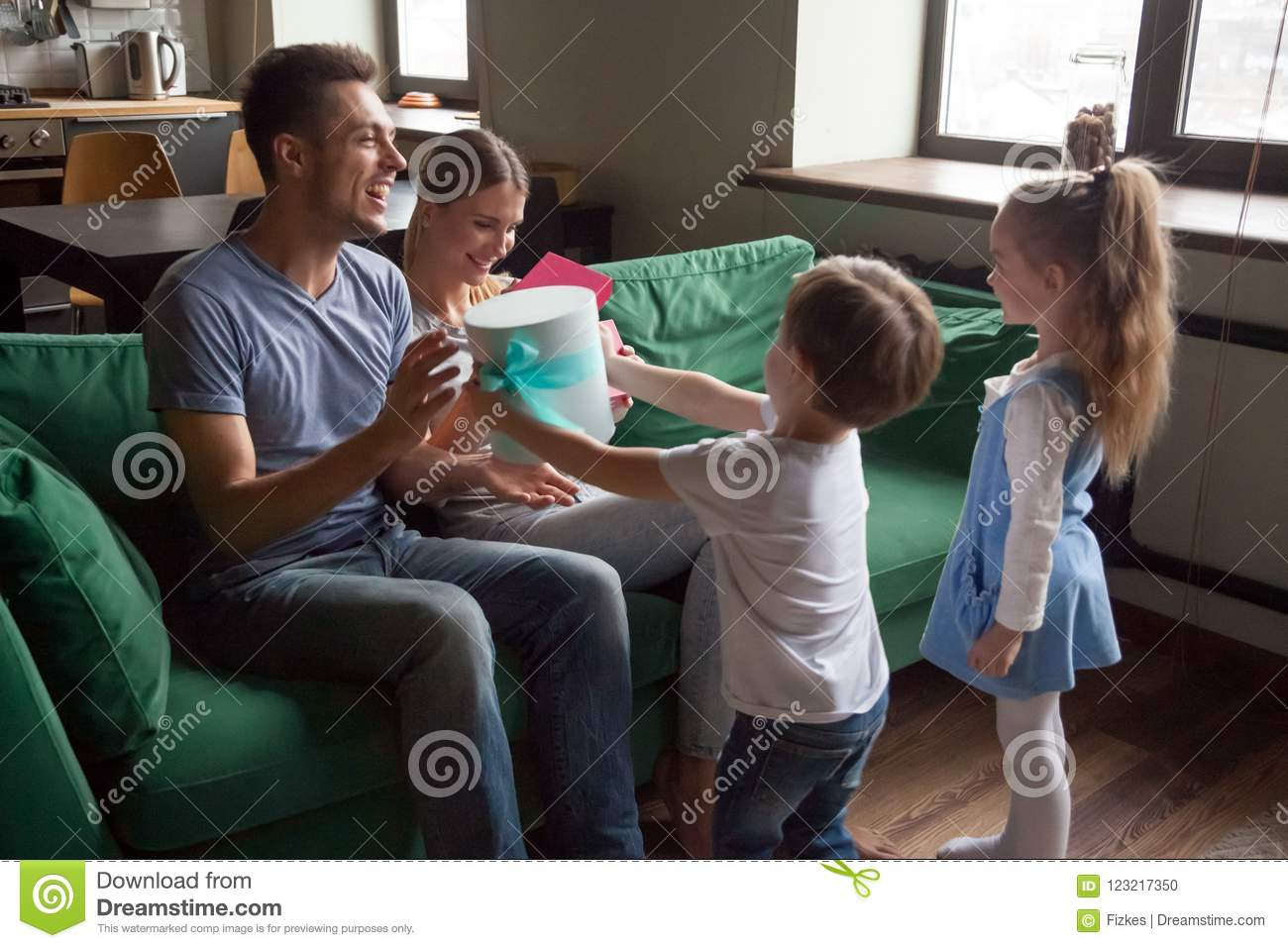 Parents Are Making Their Children Drink >> Kids Giving Excited Parents Gift Boxes Making Presents At Home Stock