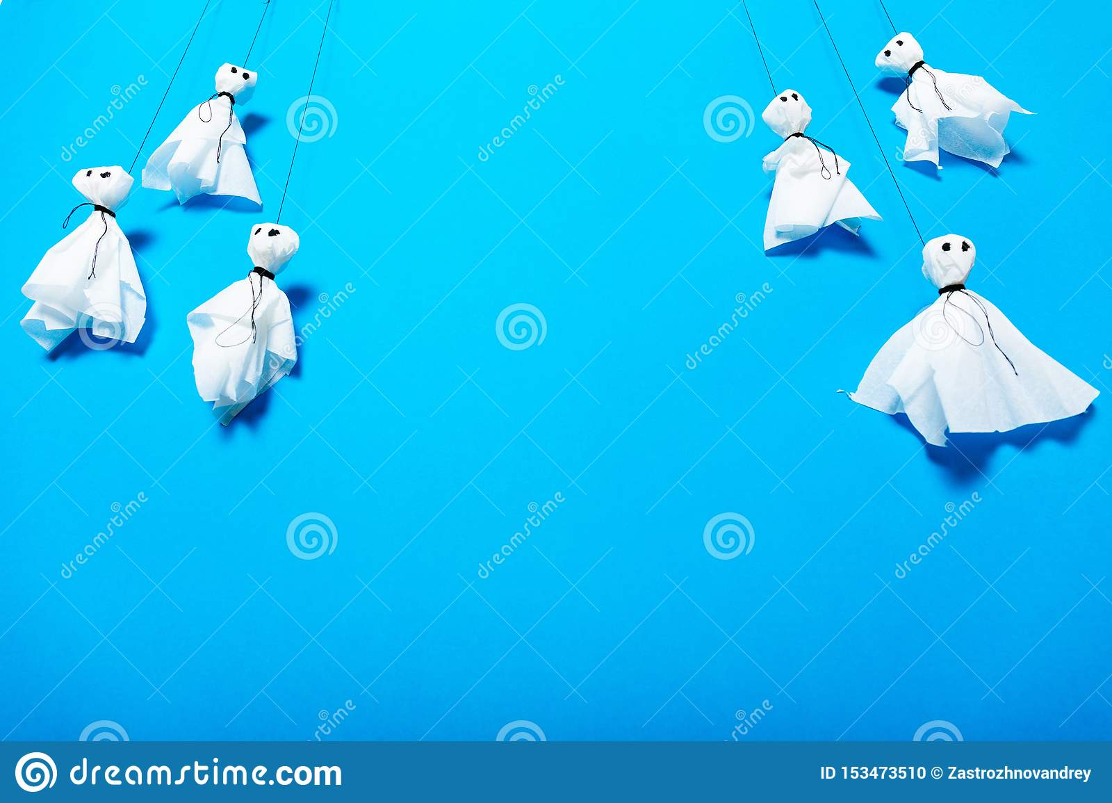 Kids spooky art, halloween celebration, paper ghosts background. Copy space for text