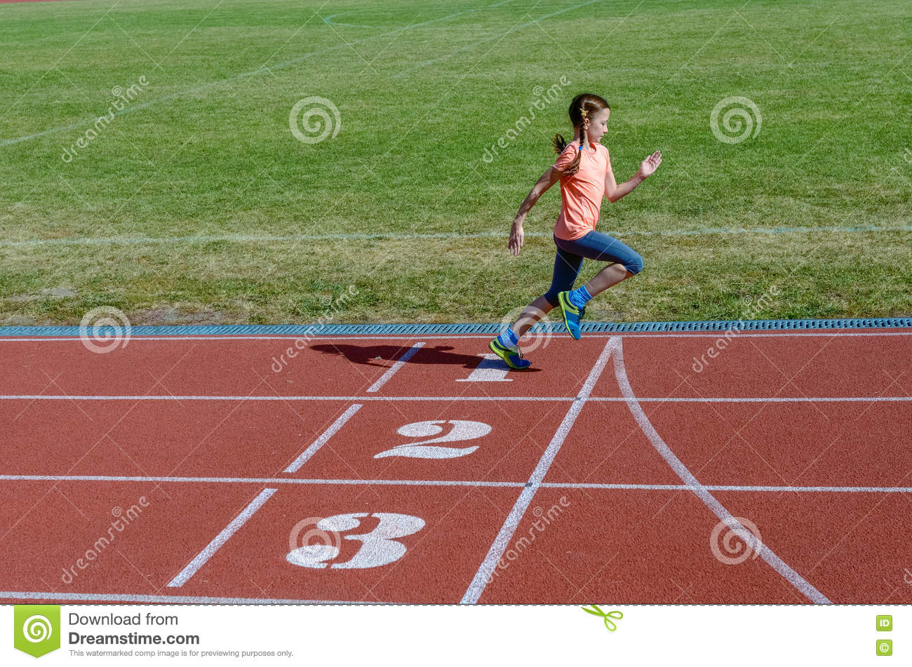 Kids sport, child running on stadium track, training and fitness