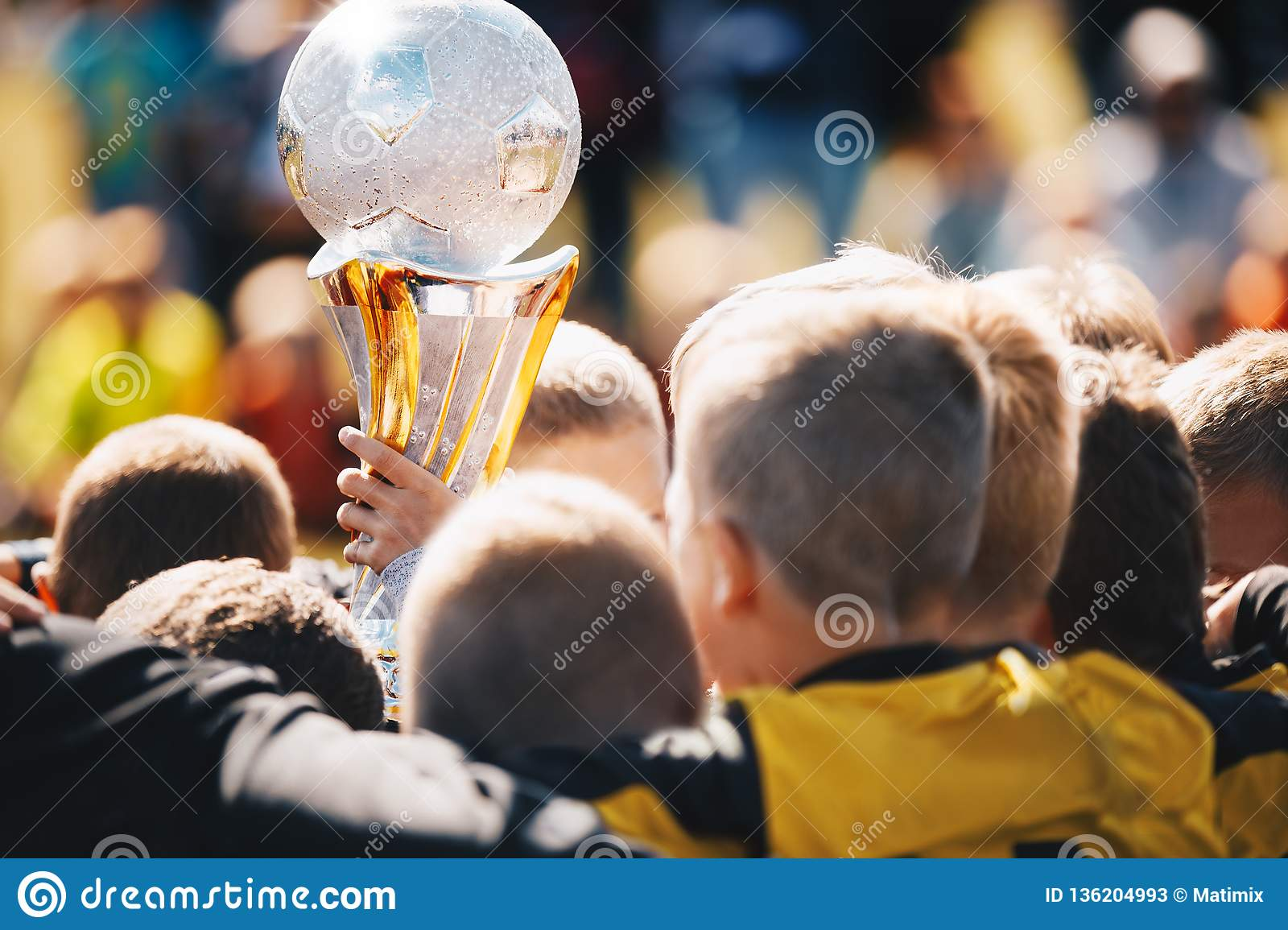 Kids Sport Team with Trophy. Kids Celebrating Football Championship