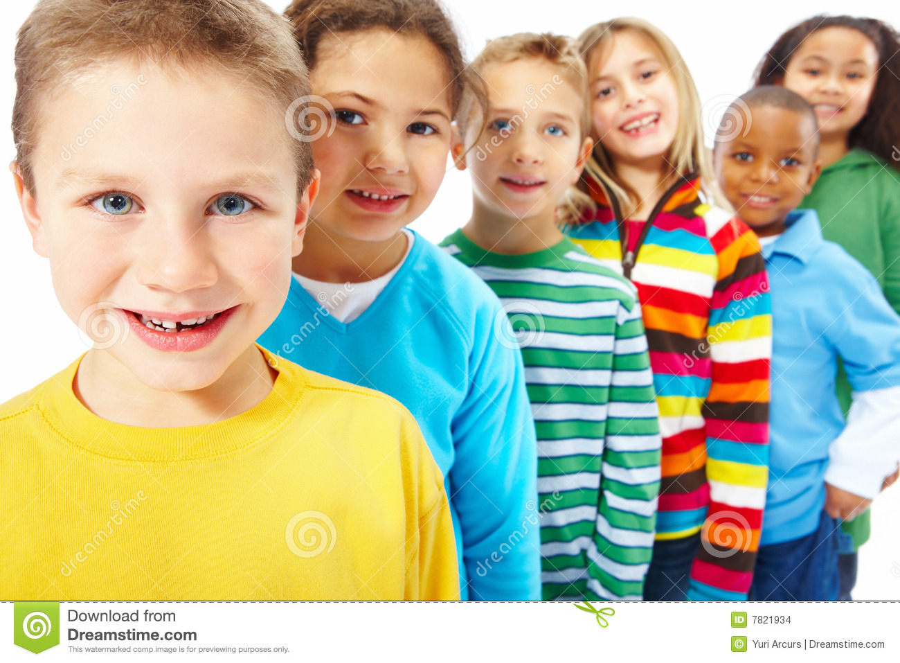 Kids Standing In A Row One Behind The Other Stock Photo