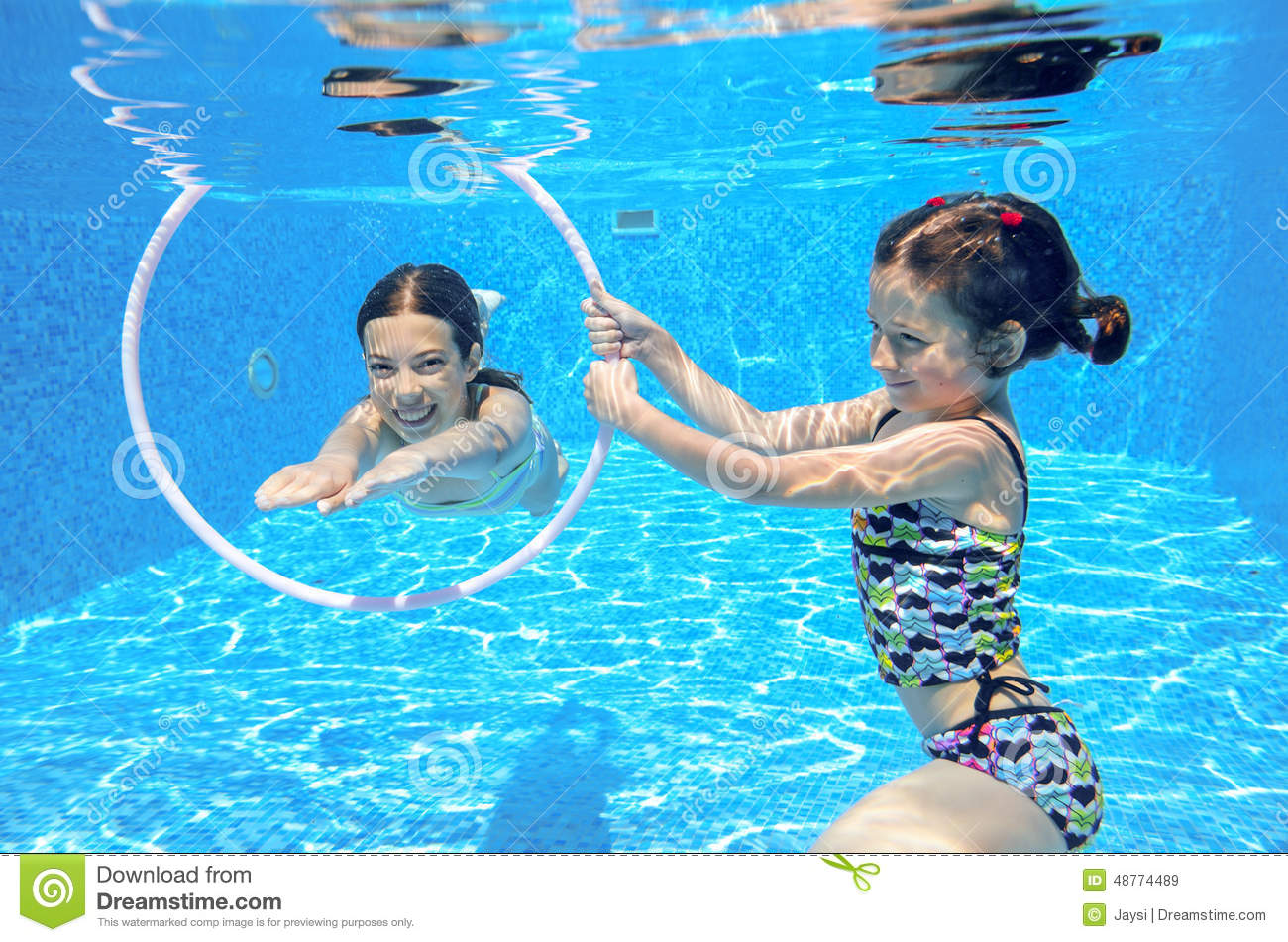 Kids Swimming Underwater kids swim in pool underwater stock photo - image: 48774489