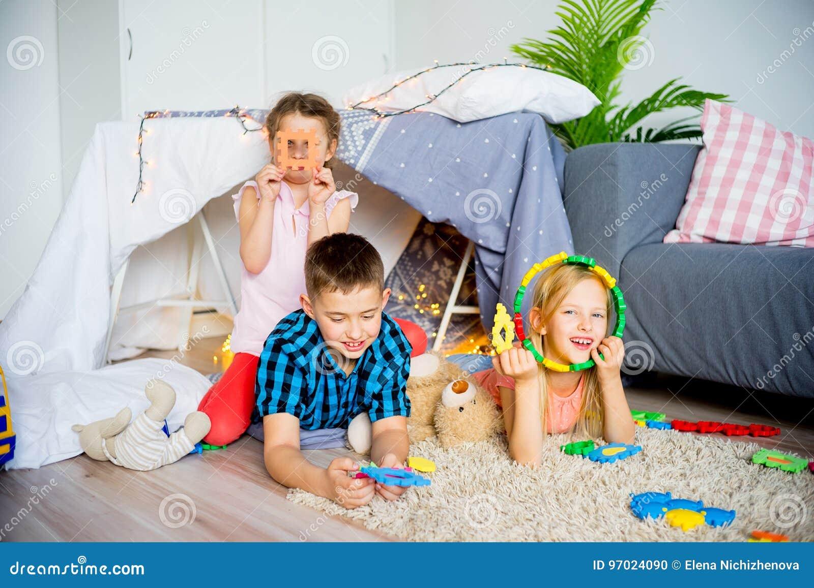 Kids in a teepee