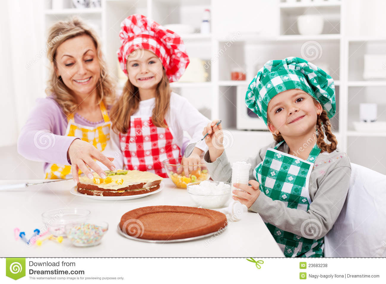 Kids And Their Mother Making A Cake Royalty Free Stock
