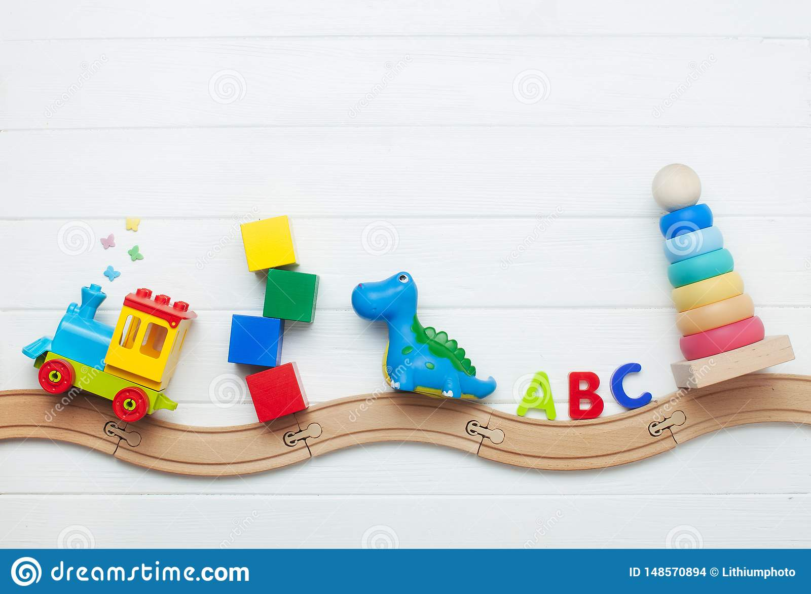 Kids Toys On Toy Wooden Railway On White Wooden Background