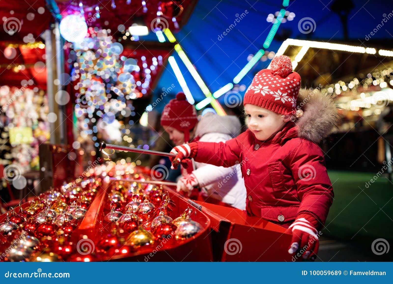 Kids At Christmas Fair. Children Shopping Xmas Gifts. Stock Image ...