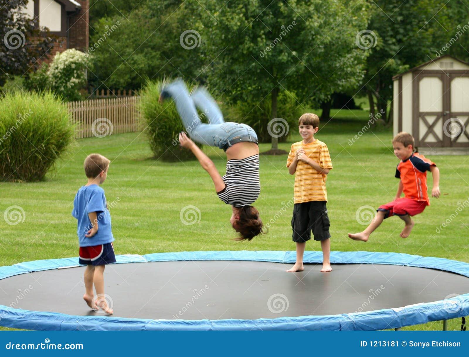 Kids On Trampoline Stock Image Image 1213181