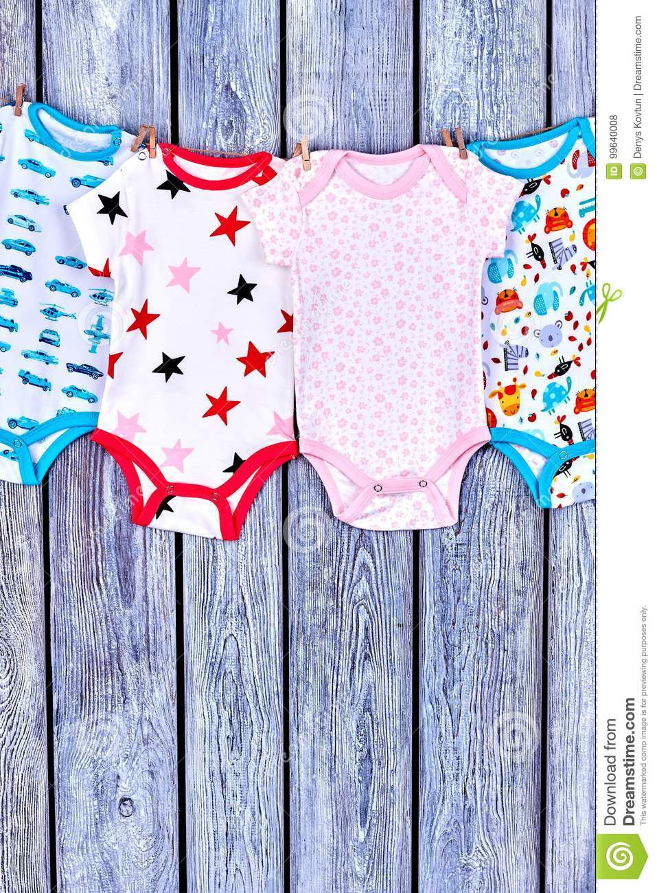 f6ddda80f Kids Washed Clothes On Rope. Stock Photo - Image of newborn
