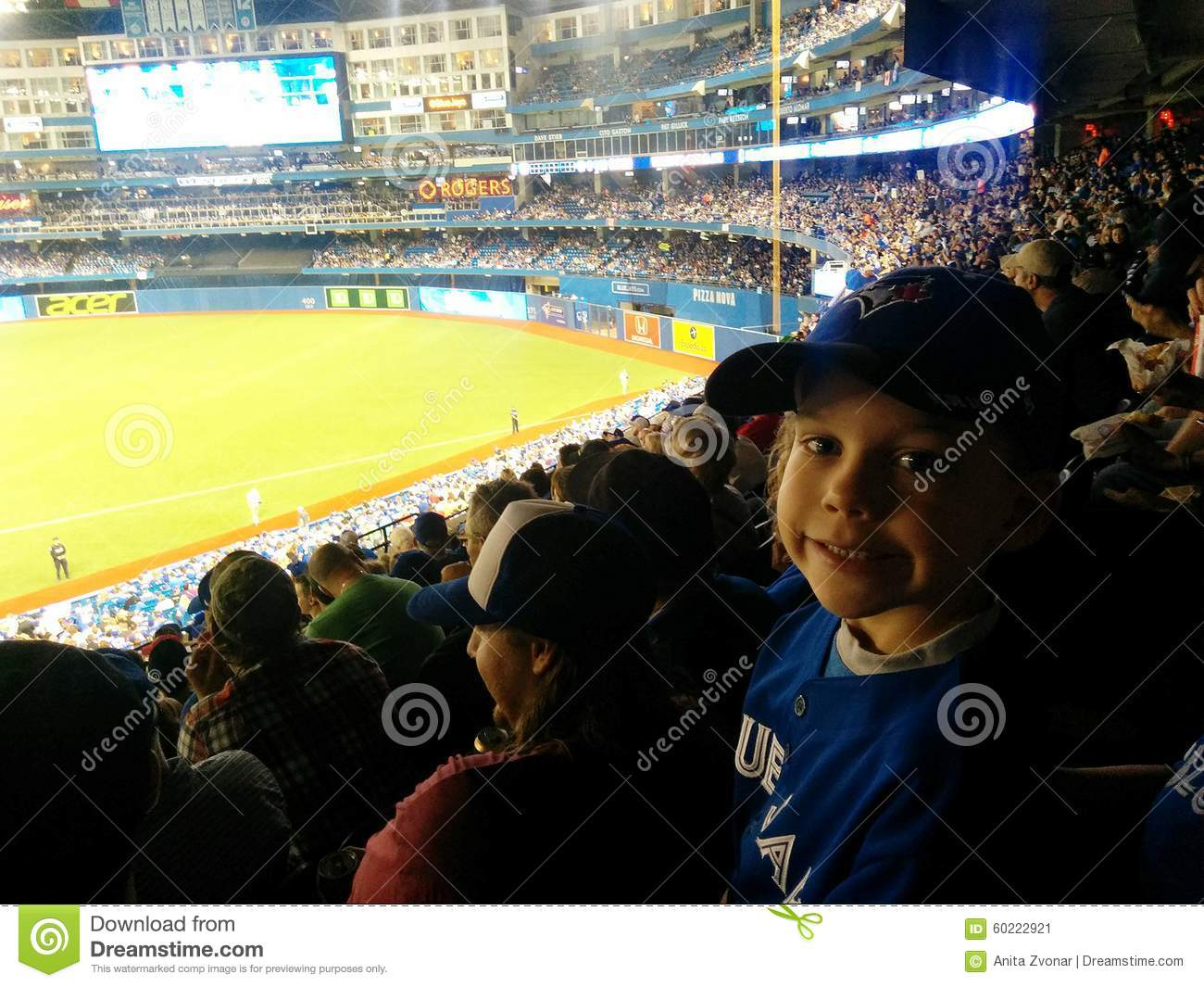 aa0c8fe8efa3 Blue jays baseball at the rogers centre in toronto. Watching a jays game.  Young blue jays game. boy watching a blue jays game. kids at sporting  events. blue ...