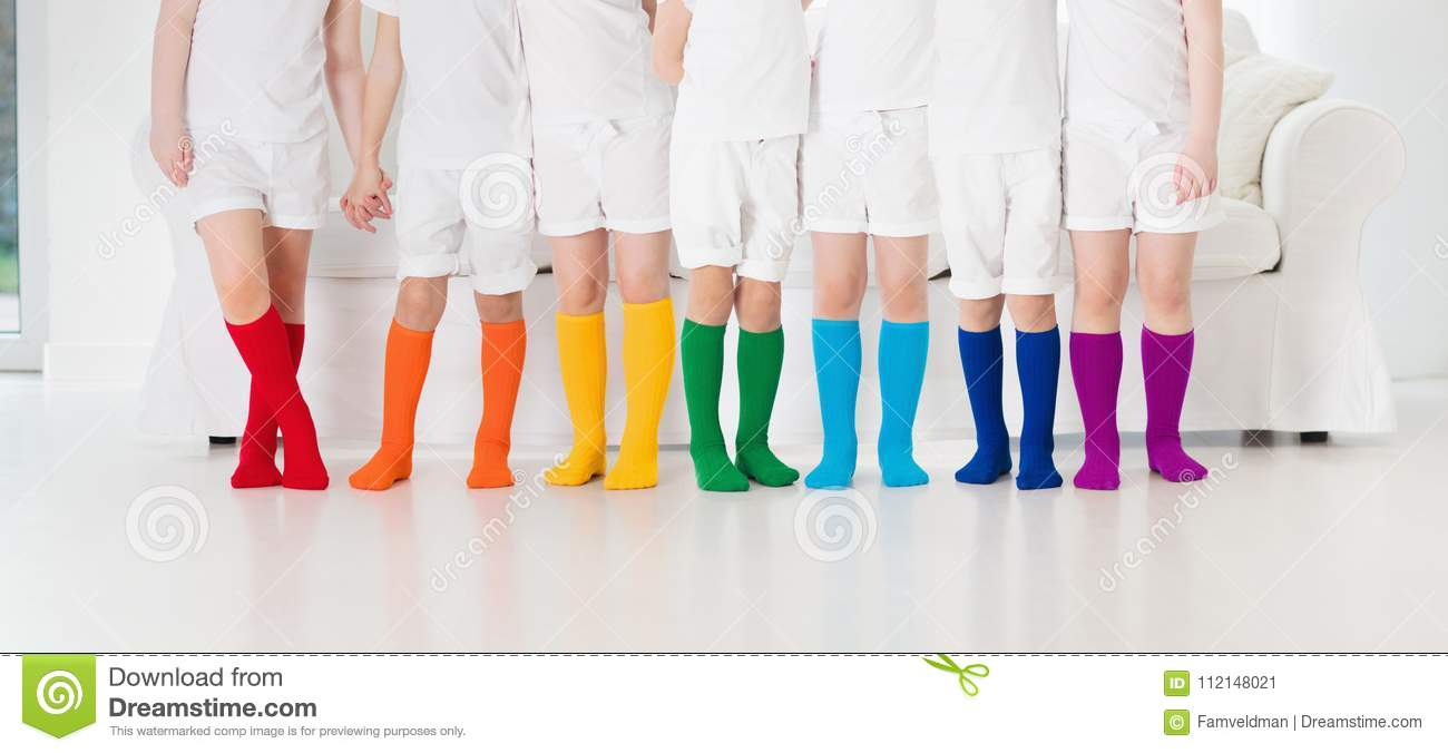 5f8b032b279 Kids wearing colorful rainbow socks. Children footwear collection. Variety  of knitted knee high socks and tights. Child clothing and apparel. Kid  fashion.