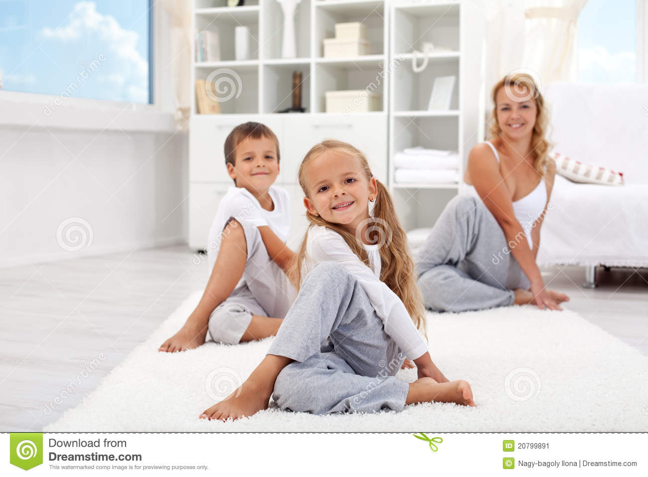 Kids And Woman Doing Stretching Exercises Stock Image