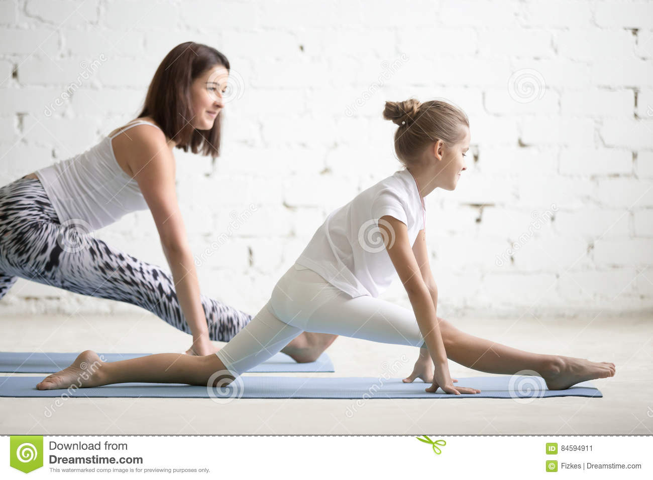 Kids Yoga Teacher Training With A Child A Hanumanasana Pose Stock Image Image Of Cheerful Partner 84594911