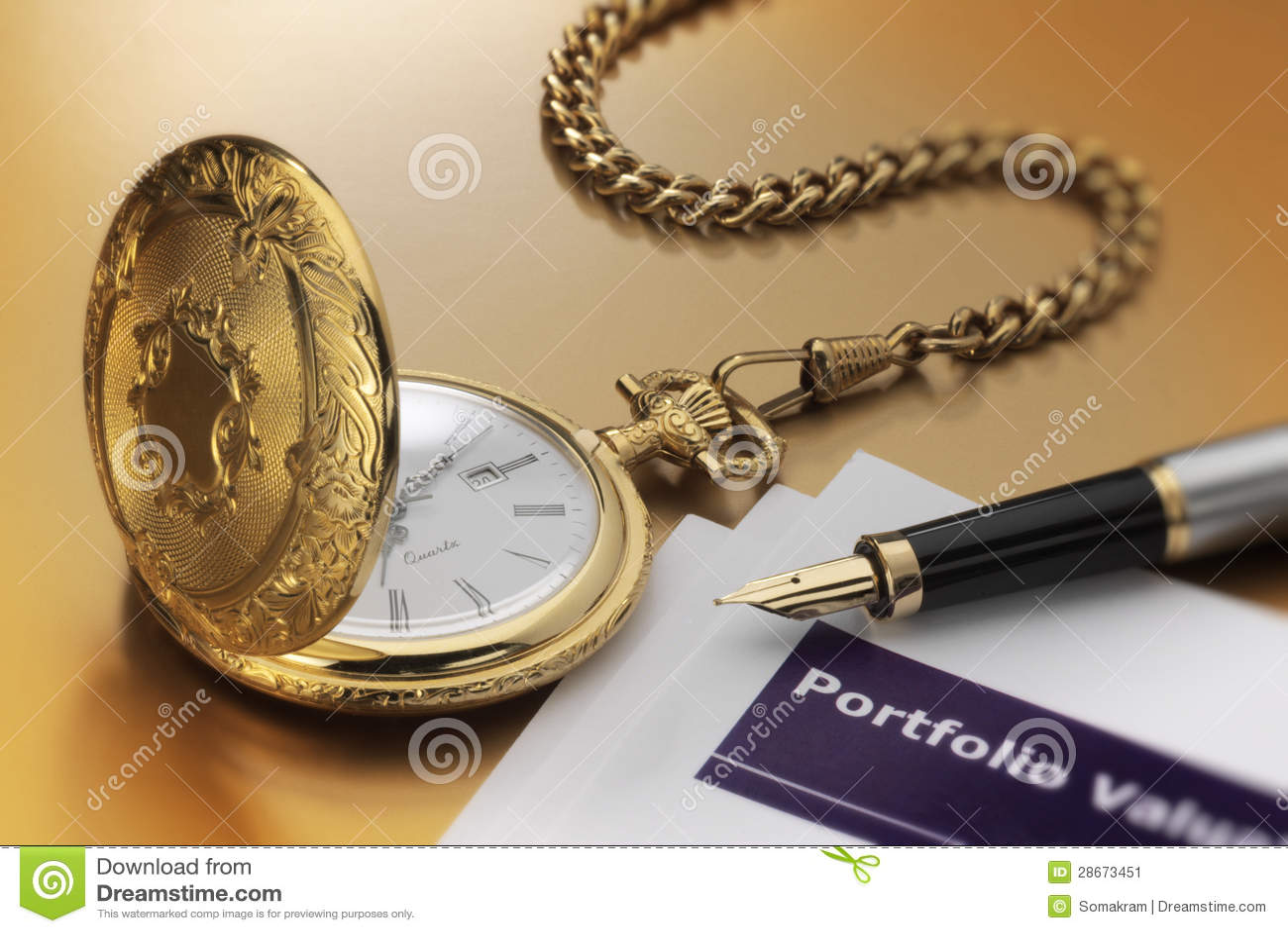 Kieszeniowy zegarek i pióro